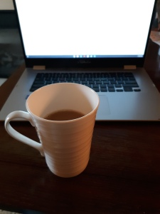 mug of coffee and a laptop
